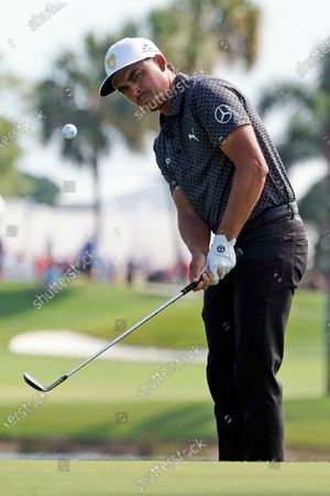 Rickie Fowler hits to the third green during the second round of the Honda Classic golf tournament, in Palm Beach Gardens, Fla