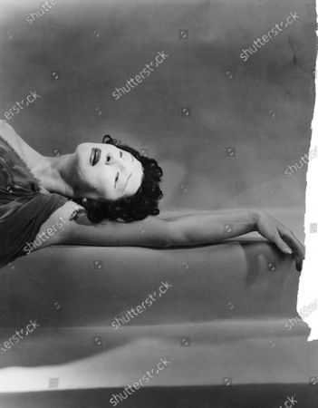 Judith Anderson, arm outstretched, in a scene from Medea. Judith Anderson