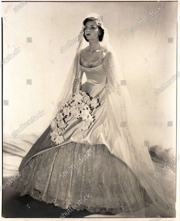 Mrs. Albert George Rupp (formerly Cynthia Foy) in her wedding gown holding bouquet. Cynthia Rupp