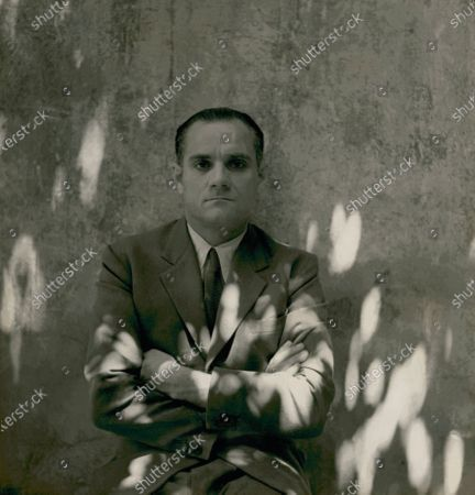 Italian writer Moravia, with arms crossed. Alberto Moravia