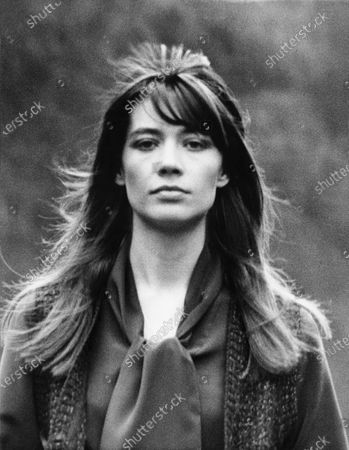 Head shot of Françoise Hardy, French singer, wearing a knit vest and blouse by Yves St. Laurent. Francoise Hardy