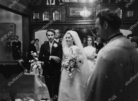 Nicholas Sistovaris and Josephine Chaplin at the altar, during their wedding ceremony, in a Greek Orthodox church near Lausanne, Switzerland, with Victoria Chaplin, the bride's sister, behind her. Nicholas Sistovaris, Josephine Chaplin, Victoria Chaplin