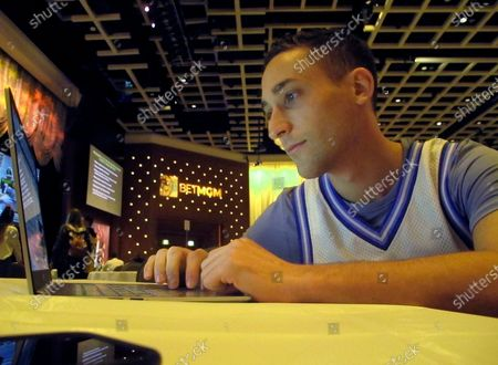 """Jonathan Price of New York researches picks for the March Madness college basketball championship tournament on at the Borgata casino in Atlantic City, NJ. Hugely disappointed when last year's tournament was canceled due to the coronavirus outbreak, Price says, """"We're owed a March"""