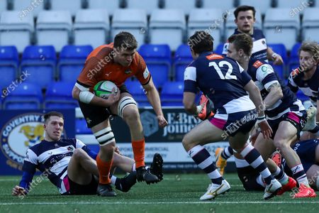 James Cannon of Ealing Trailfinders barrels towards the Coventry Rugby line, confronted by Will Owen of Coventry Rugby