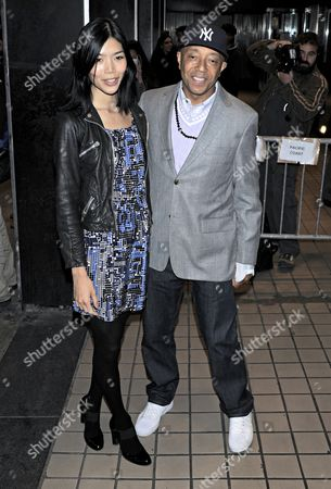 Stock Image of Angie Hsu and Russell Simmons