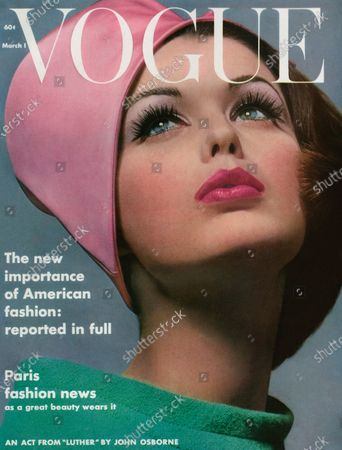 Vogue March 01, 1962 Magazine Cover featuring: Model, Dorothea McGowan, wearing bright pink hat and green dress with loose collar. Dorothea McGowan