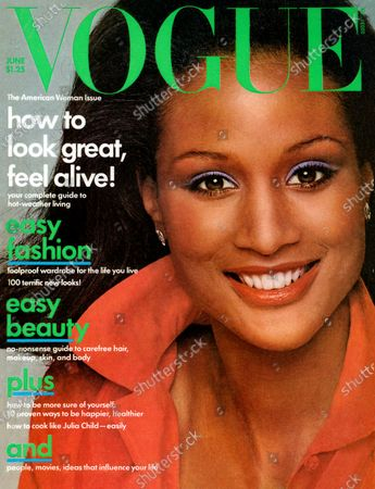 Vogue June 01, 1975 Magazine Cover featuring: Vogue green logo; Model, Beverly Johnson in red shirt with collar turned up by Dana Cote d'Azur with M & J Savitt earrings. Beverly Johnson