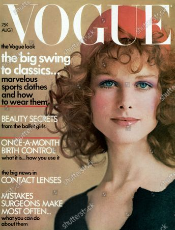Vogue August 01, 1971 Magazine Cover featuring: Vogue white logo; Model Pat Dow wearing a Juliano Knit sweater dress with Bonnie Bell make-up; Hair by Maury Hopson. Pat Dow