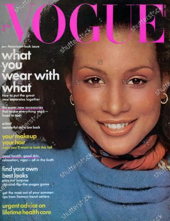 Stock Photo of Vogue August 01, 1974 Magazine Cover featuring: Vogue pink logo; Model, Beverly Johnson (first black model to appear on American Vogue cover) in Kasper for J.L. Sport sweater with a Ferragamo scarf. Beverly Johnson