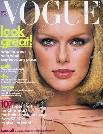 Vogue November 01, 1975 Magazine Cover featuring: Vogue white logo; Model Patti Hansen in peach crepe de chine dress by Scott Barrie with David Webb jewelry. Patti Hansen