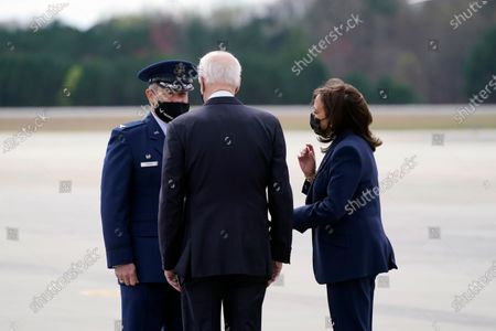 President Joe Biden and Vice President Kamala Harris are greeted by Air Force Col. Craig McPike, right, as they arrive at Dobbins Air Reserve Base in Marietta, Ga