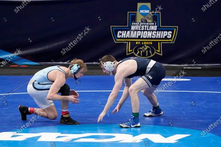 North Carolina's Zachary Sherman, left, takes on Penn State's Nick Lee during their 141-pound match in the quarterfinal round of the NCAA wrestling championships, in St. Louis