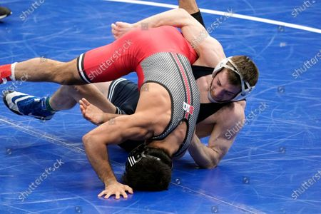 Stock Picture of Rutgers' Sebastian Rivera takes on Penn State's Nick Lee, right, during their 141-pound match in the semifinal round of the NCAA wrestling championships, in St. Louis