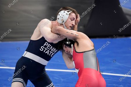 Stock Photo of Rutgers' Sebastian Rivera, right, takes on Penn State's Nick Lee during their 141-pound match in the semifinal round of the NCAA wrestling championships, in St. Louis