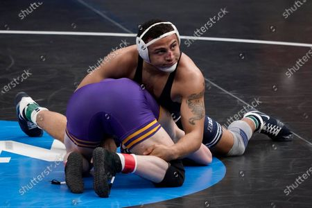 Penn State's Aaron Brooks, top, takes on Northern Iowa's Parker Keckeisen during their 184-pound match in the semifinal round of the NCAA wrestling championships, in St. Louis