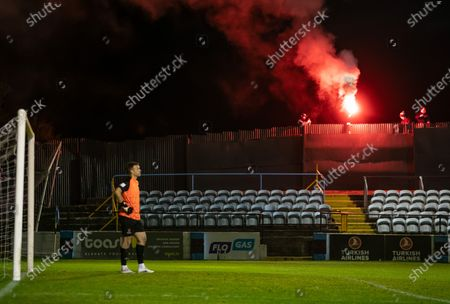 Drogheda United vs Waterford. Waterford goalkeeper Brian Murphy watches on as Drogheda fans outside the fence let off a flare to celebrate their goal