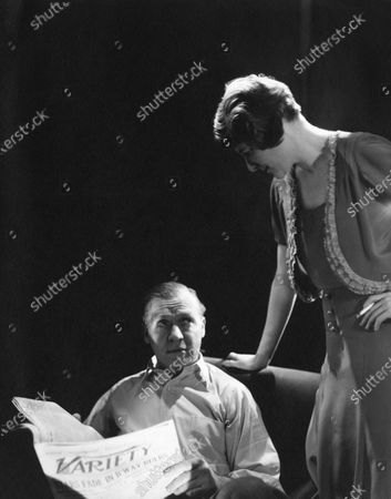 """American actor Hugh O'Connell seated with an open """"Variety"""" newspaper, and actress Jean Dixon standing to his right, gazing down; both in character for George Kaufman and Moss Hart's 1930-1931 Broadway play """"Once in a Lifetime."""". Hugh O'Connell, Jean Dixon"""
