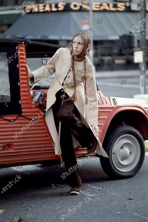 Former model and Vogue stylist Tonne Goodman wearing suede button-front coat brown jersey pants by Frank Masandrea for Modelia with Petroff clogs by Abratt, Coro rings, Thomas Robbins chain and K.J.L. earrings; Hair by Phillip Mason of Vidal Sassoon. Tonne Goodman