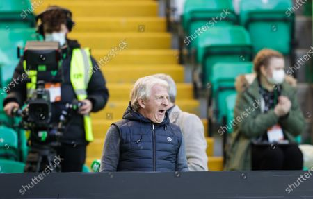 Ex-Celtic and Scotland manager Gordon Strachan working as a pundit for Scottish TV yawns at half time