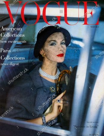 Vogue March 01, 1957 Magazine Cover featuring: Model Joan Friedman wearing blue tweed suit and cape seen through car window. Joan Friedman