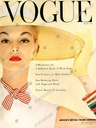 Vogue May 15, 1954 Magazine Cover featuring: Model Jean Patchett in white shirt, red and white striped bow, straw hat and multicolored bracelets. Jean Patchett