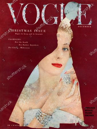 Vogue December 01, 1953 Magazine Cover featuring: Woman covered in snow and diamonds, seen through silhouette of woman in long gown.