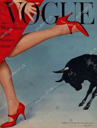 Vogue February 15, 1958 Magazine Cover featuring: Woman's legs in red skirt and pumps, with bull on right.