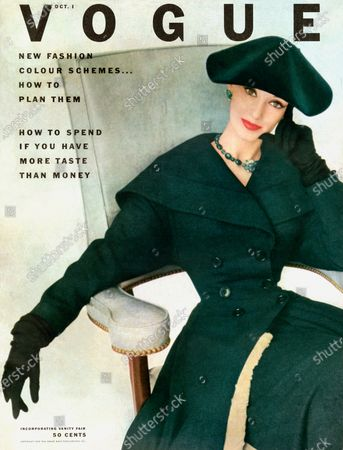 Vogue October 01, 1952 Magazine Cover featuring: Model Barbara Mullen seated in grey chair dressed in emerald hat and coat. Barbara Mullen