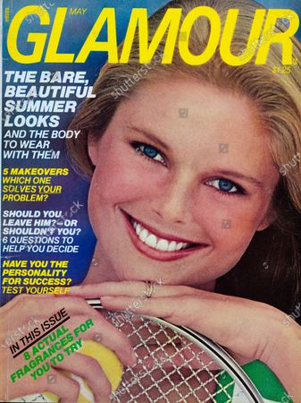 Glamour May 01, 1976 Magazine Cover featuring: Christie Brinkley wearing Estée Lauder makeup and t-shirt from Stag White, with a tennis racket and tennis ball. Christie Brinkley