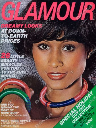 Stock Image of Glamour December 01, 1976 Magazine Cover featuring: Beverly Johnson wearing Avon makeup, Capri earrings, and Red Cobra choker and bangles. Beverly Johnson