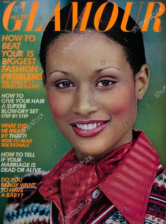 Glamour October 01, 1973 Magazine Cover featuring: Beverly Johnson wearing Helena Rubinstein makeup, red shirt and ascot by Peter G, and striped Kitty Hawk sweater. Beverly Johnson