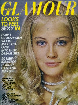 Glamour December 01, 1969 Magazine Cover featuring: Cybill Shepherd wearing makeup by Helena Rubinstein, silver cardigan and dress by Maggie Stover, and silver metallic rope at neck by Capri. Cybill Shepard