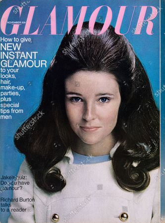 Glamour November 01, 1966 Magazine Cover featuring: Lisa Palmer in white chinchilla double-breasted coat with silver buttons over pale blue crepe dress, by Victor Joris, and earrings by K.J.L. Lisa Palmer