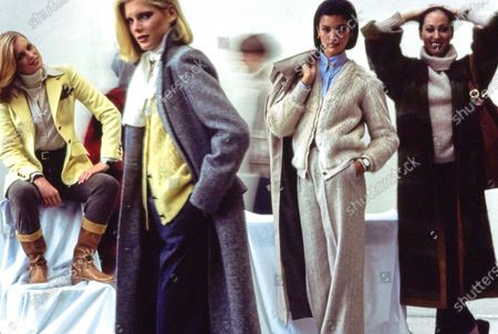 Stock Image of Models (from left to right) Patti Hansen, Lisa Cooper, Janice Dickinson, and Pat Cleveland wear various ensembles from Calvin Klein for Fall 1976. Hansen wears a wool-and-acrylic turtleneck sweater, cotton tattersall shirt, chamois-yellow Shetland wool jacket, cotton corduroy pants, Hermès belt, and Campione shoes. Cooper wears a wool Harris tweed coat, yellow Shetland wool vest, wool-and-polyester flannel pants, Trifari earrings, and Geoffrey Beene scarf. Dickinson wears grey wool tweed pants, blue silk shirt, nutria fur sweater edged in ribbing (by Calvin Klein for Alixandre), poplin raincoat in polyester and cotton, Monet earrings, M&J Savitt bar pin, and Omega watch. Cleveland wears unlined plaid mohair coat, grey turtleneck sweater, and cotton denim jeans. Hair by Edward Trigomi, makeup by Sophie Levy; both of Xavier of New York. Patti Hansen, Lisa Cooper, Janice Dickinson, Pat Cleveland