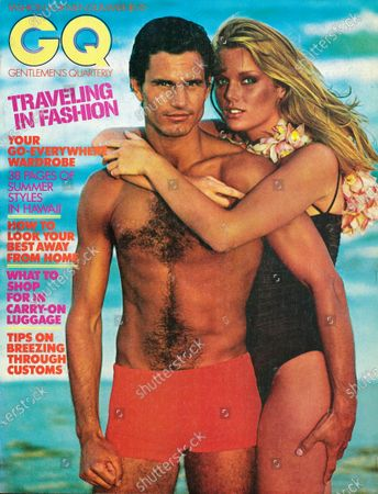 Stock Image of GQ June 01, 1977 Magazine Cover featuring: Summer 1997 issue: male model wearing red polyester and nylon swimsuit by Jantzen arm in arm with model Patti Hansen wearing swimsuit by Kamali and orchid lei from Tony's Flower Shop, New York City in front of Hawaiian surf.