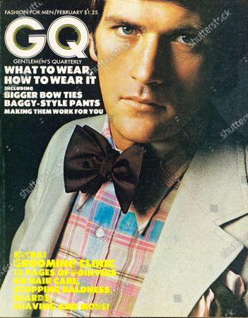 GQ February 01, 1973 Magazine Cover featuring: Model wearing a Corbin Ltd. polyester-wool-silk suit, an Eagle pastel plaid shirt, a Ruffler silk bow tie, and a Dumont silk pocket square.