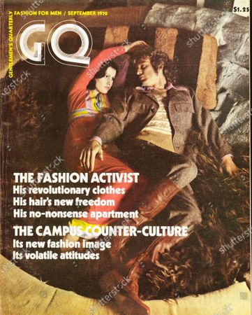 GQ September 01, 1970 Magazine Cover featuring: Couple resting on rug, female wearing a Santos Santiago dress, male wearing a Raffles Wear casual suit, with pleated slightly flared pants, a Sabre sweater, and Renegades boots.