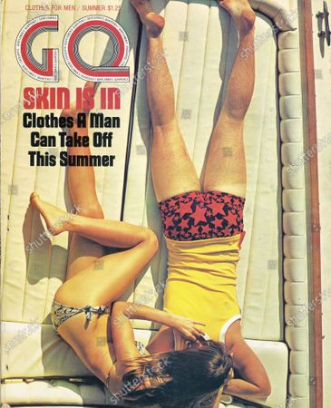 GQ June 01, 1971 Magazine Cover featuring: Couple, face down on a boat deck, wearing Sea Mark swimwear. Summer Issue.