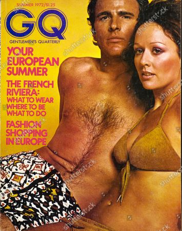 GQ June 01, 1972 Magazine Cover featuring: Couple in bathing suits, male model wearing a McGregor screen-printed, contour-fitting nylon suit with an industrial-type zipper. Summer Issue.