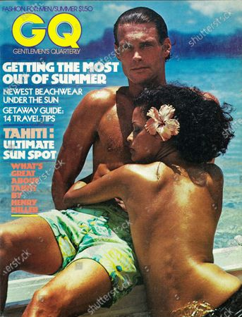 GQ June 01, 1975 Magazine Cover featuring: Male model,wearing Catalina cotton swimsuit, with a topless female model with flower in her hair, in Tahiti. Summer Issue.