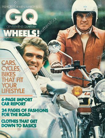 GQ March 01, 1975 Magazine Cover featuring: White logo superimposed over photo of a man in a car and another man atop a Honda 750 motorcycle wearing a baby-lamb jacket by Luis Garcia Alvear for Arbitro, a Jeager shetland sweater, Grandoe driving gloves and a Buco Products helmet.