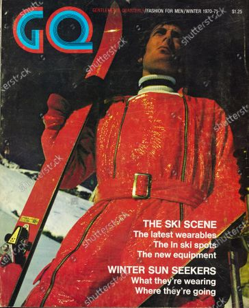 GQ December 01, 1970 Magazine Cover featuring: Model on ski slope wearing red crinkle patent leather jumpsuit by Ernst Engel. Winter Issue.