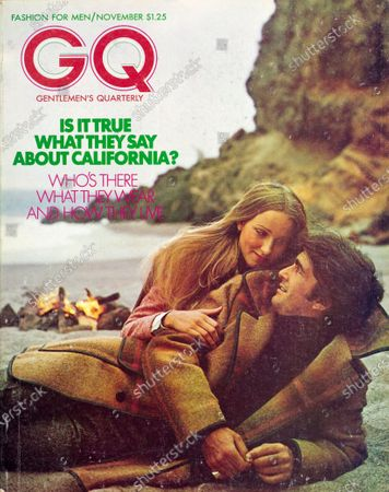 GQ November 01, 1972 Magazine Cover featuring: Couple on Malibu Beach in California, with male model wearing a Pendleton blanket-plaid coat trimmed with leather and plaid slacks, and a Jackie Rogers turtleneck, with campfire and ocean in background.
