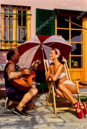 Model Christy Turlington in Portofino wearing Randolph Duke's high-waisted bikini and espadrilles by J.Crew. Christy Turlington