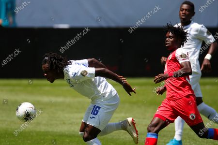 Jose Garcia (L) of Honduras vies for the ball against Roberto Louima (R) of Haiti, during a match, between the national teams of Honduras and Haiti, of the CONCACAF Men's Olympic Qualification tournament, at the Jalisco Stadium, in Guadalajara, Mexico, 19 March 2021.