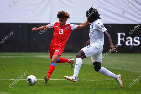 Jose Garcia (R) of Honduras vies for the ball with Martin Experience of Haiti during a match, between the national teams of Honduras and Haiti, of the CONCACAF Men's Olympic Qualification tournament, at the Jalisco Stadium, in Guadalajara, Mexico, 19 March 2021.