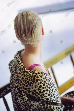 """Stock Photo of Model Stina Fry, turned away from camera, showing her """"cropped back, long bang"""" short haircut by Oribe for Oribe at Parachute, NYC. She is wearing a cotton/polyester velour leopard print robe by Adrienne Vittadini At Home for Boutique Industries over a Antron/Lycra fuchsia bodystocking from Lynne Greene for Lady Lynne. Makeup by Sonia Kashuk. Stina Fry"""