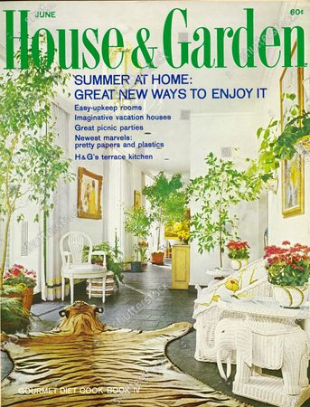 House & Garden June 01, 1967 Magazine Cover featuring: House & Garden logo in green print superimposed on photo - hallway of New York apartment designed by Diane Tate and Marian Hall: slate floor, high ceiling and windows, white walls ; large tiger skin and head on floor whit wicker furniture; many ficus trees,cachepots and lavebos of red blooming plants.