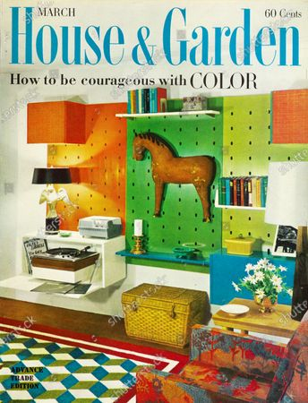 House & Garden March 01, 1961 Magazine Cover featuring: Color issue with blue House & Garden logo superimposed on photo of room by designer Paul Krauss: Ready-made components from Conant Ball's Modernmates Wall Group, designed by Bert England; rug assembled from Caravan Carpet's Magic Carpet Tiles of Avicron rayon; armchair with fabric by Jack Lenor Larsen.