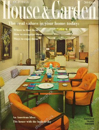 House & Garden October 01, 1959 Magazine Cover featuring: Real values in your home issue - House & Garden logo in white superimposed on photo of dining room as recreated by W & J Sloane, New York, taken from a house designed for Celanese Corporation by architect, Edward Durrell Stone: sofa and wood-framed upholstered chairs around rectangular dining table with wooden top and metal legs, table set with Iroquois Su-Shi china, Celsa Avanti sterling flatware, and Exquisite: Pasco Austrian glassware; all furniture by Edward Wormley for Dunbar in Celanese contemporary fibers; all rooms have large coved ceiling with center skylight and custom hanging fixture with green plants cascading over the edges.